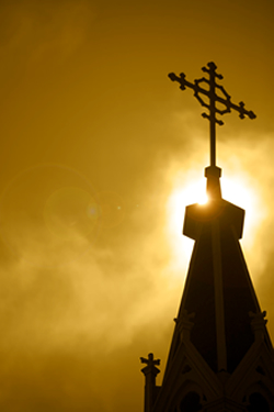 A Church Cross at Dusk