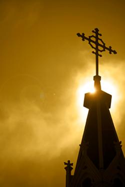 A Church Cross at Dusk