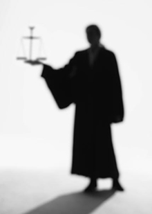 Robed Silhouette holding Scales